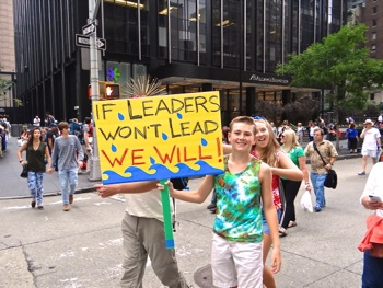 photos marchers signs people's climate march